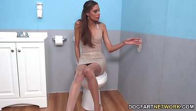 Skinny model masturbates pussy and jerks off cock sticking out of the wall