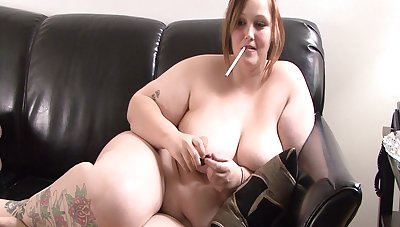 Curvy BBW with nice ass posing seductively superior to before love-seat while smoking