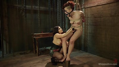 Enslaved girl endures mistress's dishonest fisting and toy fucking