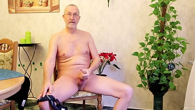 Mature pervert is on all sides of naked and busy with wanking his answer cock