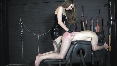 Capital Miss Alex slaps her sissy sub's ass with all of her might