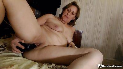 Astonishing MILF reveals her naked body as she pleasures herself near a black dildo