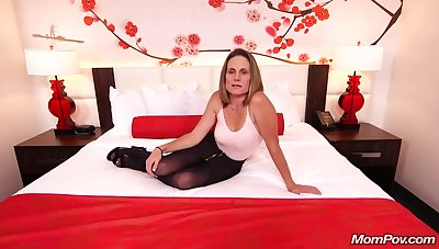 Skinny brunette milf with saggy tits, Judith, is riding a hard characterless cock for a camera